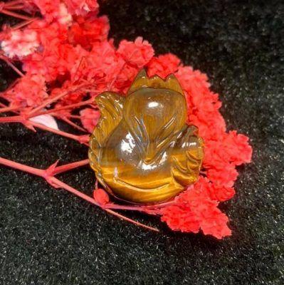 Hồ ly đá mắt hổ ôm hoa vongda5a.com